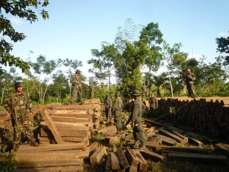 Troops of a Nicaraguan army eco battalion confiscate an illegal shipment of logs from the Bosawas biosphere reserve. Eco battalions were set up in Nicaragua in 2011 to protect Nicaraguan forests.
