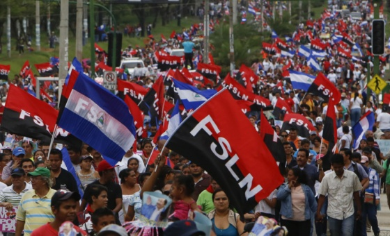 Nicaraguans march for peace and in support of the FSLN government